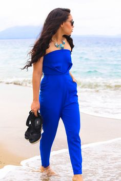 The stunning blue of this jumpsuit screams SUMMER! Why not try a look like this next time you're getting a little dressed up?