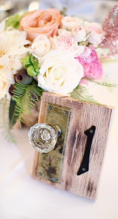 Door knob table numbers, SOOO cute!!! @Kristin Polhemus ➳ R E V E R I E™ Events PA Wedding