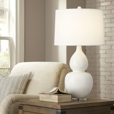"""Birch Lane Stillwell Table Lamp Features Made of ceramic Wipe with a clean, dry cloth Made in the USA Bulb type:150 W the lamp has an on/off switch. Dimensions & Specs Overall: 33"""" H x 18"""" W x 18"""" D Overall Product Weight: 14lbs"""