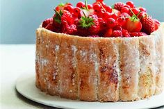 Red Berry Charlotte recipe | It was the French pastry chef Carême who transformed the cake into what it is today – usually an exterior of light ladyfingers and an interior of vanilla cream or flavoured mousse. Bread, sponge cake or biscuits/cookies are used to line a mold, which is then filled with a fruit puree or custard.