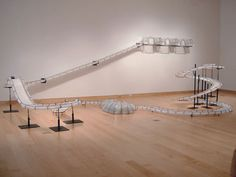 a modular installation piece by sabrina raaf, 2003. Materials: Steel, rubber, RC car and Remote, custom chairs, dimensions variable.