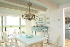 Awesome look for my in-laws mobile home; trailer living; Awesome frame on diningroom wall-easy DIY letters-painted distressed craiglist or thrift store furniture, table & chairs finds...   House of Turquoise:  Coastal Living Idea Cottage designed by Tracey Rapisardi