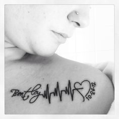 Black Ink Name With Heartbeat Tattoo On Front