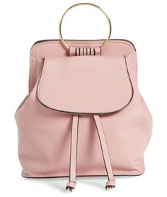 ring handle backpack by Amici Accessories. A golden ring handle adds trendy style to the top of this pretty little backpack crafted from blush-hued faux leather.