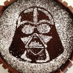 Getting ready for the next installment of Star Wars. Chocolate cake with Twix exterior. Darth Vader made from powdered sugar.
