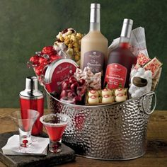Holiday Cocktail Mixers - $129.95 This stunning cocktail mixer set has everything you need for a sophisticated holiday party. Nestled in a large stainless steel container are gourmet home bar essentials, stemless martini glasses, a full-size cocktail shaker, flavored martini mixers, a variety of peppermint and chocolate sweets to enjoy with your drinks, and more. Share this red- and silver-themed cocktail gift set and make a big impression this holiday season.