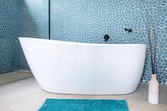 Take a relaxing bath surrounded by stunning Spindrift Pebbles 11 3/4 x 11 3/4 Glass Tile. The perfect natural stone backsplash the glass pebbles interlock to create a flat surface with a soft satin finish. It retails starting at $30.42 SQ FT.