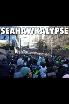 The crowd in downtown Seattle for the Superbowl parade! Seahawkalypse!!! Go Seahawks!