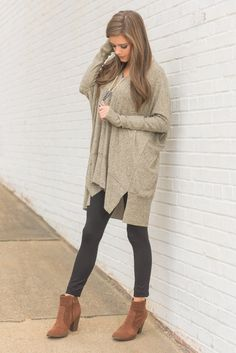 """""""Calling My Name Tunic, Taupe"""" This tunic has been calling our name since it came in the door!! It's fabric is the ultimate when it comes to being soft and fuzzy! The color is pretty epic too! It looks great with black and brown leggings or boots! #newarrivals #shopthemint"""