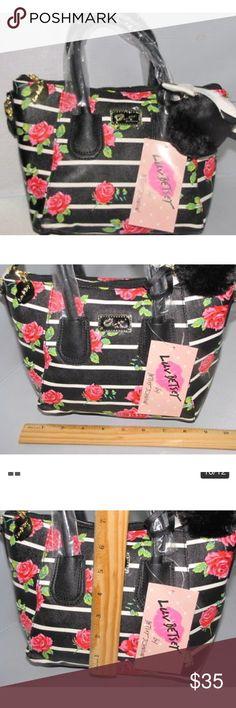"NWTBetsey Johnson Black Stripe Floral Satchel Bag Brand new with tag,  BRANDBetsey Johnson  Product Key Features Strap Drop4 MaterialFaux Leather StyleSatchel, Crossbody, Messenger, Shoulder Bag, Crossbody Dome Satchel Bag, Mini Crossbody bag, Satchel/Cross Body Bag Length7.5 TextureMetallic SizeSmall, Mini, Small Mini ClosureZipper, Zip ColorMulti-Color ThemeFlower PatternFloral, Striped, Multi-Colored Bag Height7.5"" Bag Depth5"" Betsey Johnson Bags Satchels"