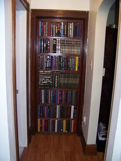 """Perfect for secret hide-aways! """"Wonderful way to disguise a door. Poor woman got so many comments about """"killing books"""" though. She used water-damaged books - best use of nonusable books (read: recycling) I've ever seen. Bookshelf Closet, Bookcase Door, Bookshelves Built In, Closet Doors, Bookcases, Hall Closet, Door Design, House Design, Hidden Closet"""