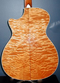Taylor 612c guitar. Quilted maple back