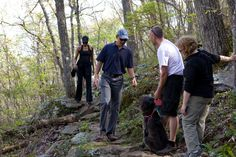President Obama and First Lady Michelle Obama have a chance encounter with other hikers while walking along a trail off the Blue Ridge Parkway outside of Asheville, N.C., April 23, 2010