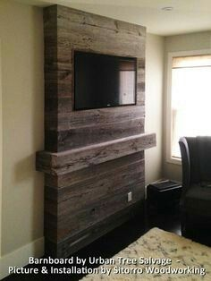 Fireplace feature wall completed with grey reclaimed barn for Winchester homes cabin branch townhomes