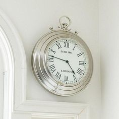 this oversized pocket watch clock brings a fun vintage feel to your walls