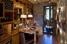 Built-in wine storage, stone walls, a vaulted ceiling and barrels create a dream Wine Room. The St. Croix Model by Toll Brothers. Sugar Land, TX.