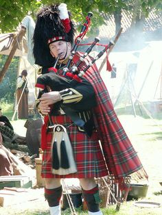 Scottish man in kilt with bagpipe