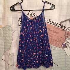 Floral tank top with open back The tie in the back can be adjusted for a better fit. I usually wear a small and this fits me great. Candie's Tops Tank Tops