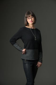 This new season black and grey knitwear design is a simple slightly widened boat neck women's possum merino sweater with contrast colour around the hips and lower arms. It is easy wearing for the weekend or smart casual for during the day at work. Made in New Zealand.