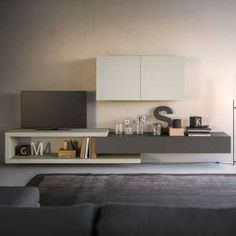 Plan 19 is a low living room wall unit featuring an original C-shaped element, wall units and cabinets with drop down door. Living Room Wall Units, Living Area, Living Room Furniture, Furniture Sets, Melamine Cabinets, High Quality Furniture, Glass Shelves, Wall Colors, How To Plan