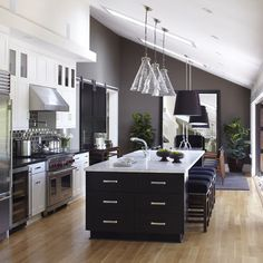 Benjamin Moore dark grey wall color. White cabinets with dark island.