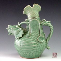 Antique Pottery Decanter with Celadon Green Dragon-shaped Body
