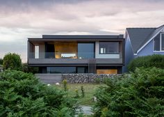 Welsh seaside home perched on the edge of cliff.