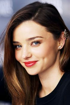 Miranda Kerr long brunette looks good. I feel great! red lips blue eyes