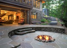 Patio with rock built in firepit and slate