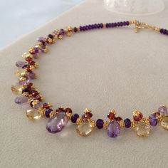 Hey, I found this really awesome Etsy listing at http://www.etsy.com/listing/100196149/semiprecious-gemstone-necklace-in-gold