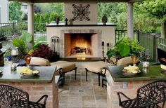 Luxury design for outdooor fireplace on tiled deck covered by roof