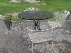 "Rod iron patio furniture needs painting but in fair condition. Table can hold a umbrella. The dia. of the table is 42"" and 30"" H"