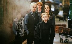 Draco and Astoria Malfoy with their son Scorpius. AND ALSO TEDDY IN THE BACKGROUND MY POOR HEART