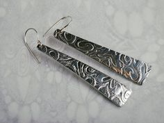 Swirl design long embossed drop earrings silver aluminium