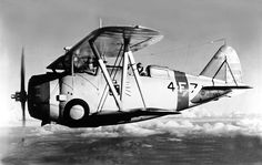 A Grumman F3F-1 fighter of U.S. Navy fighter squadron VF-4 in the 1930s- VF-4 was assigned to the aircraft carrier USS Ranger (CV-4).