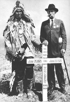 Brig. Gen. E.S. Godfrey (7th Cavalry, survivor of the Battle of Little Bighorn) at the 50th Anniversary of this battle, standing next to a Sioux Warrior in traditional dress, both in front of a newly placed engraved cross... (On the same photo, this Indian was also identified as White Man Runs Him, Custer's Crow scout !?!) - Photographer unidentified. - 1926 - (B/W copy)