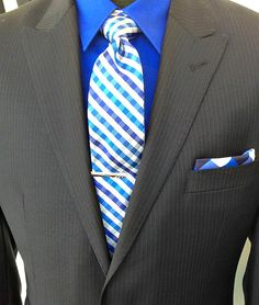 The first step in performing like an all-star is looking like one - you have to dress the part. Stay on the top of your game with the Perry Ellis suit's hand-stitched details. The vivid color of the check Wilke Rodriguez tie and stretch poplin material of the shirt will provide a comfortable fit all season long. #Suit #PerryEllis #Tie