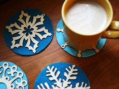 Snowflake Coaster DIY: Easy with pre made laser cut snowflake ornaments from the local craft shop and felt!