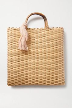 Nannacay's tasseled 'Carolyn' tote is the result of founder Marcia Kemp's dedication to employing locals around communities in Rio de Janeiro. Woven with Brazilian fibers, it has a chunky bamboo handle and an open top that's perfect for days at the beach. Lisa Marie Fernandez, Make An Effort, Personal Shopping, Casual Wedding, Who What Wear, Straw Bag, Cool Things To Buy, Neutral, Reusable Tote Bags