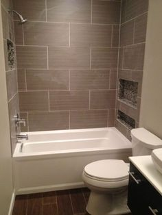 Really want custom niches with mosaic to store products. Small mosaic tiles could match sink backsplash. The large tiles are a little big.