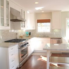 Madre Perla granite Kitchen with White Cabinets