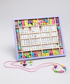 This sweet set includes over 200 beads and is perfect for sleepover parties. An assortment of butterfly and flower-shape beads allow little ones and all their friends to make personalized jewelry that they'll love to show off the next day in school.11.1'' W x 9.5'' H x 0.6'' DBead: woodBox: plywood / medium-density fiberboard