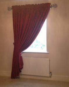 Pink slot headed curtain installation.