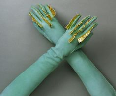 Very cool green suede and ruffled gold kid leather gloves by Elsa Schiaparelli, summer 1939.