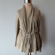 Tahari drawstring beige cardigan Absolutely beautiful. Pre-owned in great condition. No rips or stains. Size large.  Measurements: Underarm to underarm is approximately 21 inches. Length from back of neck to bottom of hem is approximately 26 1/2 inches. Materials: 55% linen/45% viscose. Tahari Sweaters Cardigans