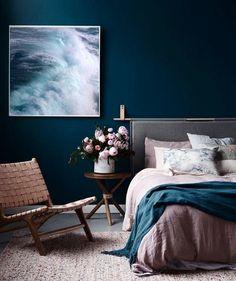 Dark bedroom wall with art