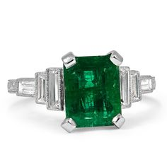 The Veata Ring from Brilliant Earth A gorgeous natural emerald is accented by six baguette cut diamonds in this Art Deco ring. Rectangular pierced detailing along the shank further enhances this rings exquisite geometric motif (approx. 0.48 total carat weight).