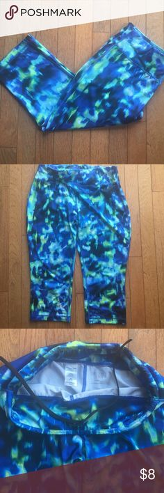 """Danskin Now Mermaid Yoga Capri Leggings💙💚 Excellent condition size medium(8-10) """"mermaid"""" pattern yoga/running capri leggings. Has a pocket on the inside of the waistband for your iPod, cash etc! Drawstrings that tuck inside ((pictured above)) so you don't have to keep pulling your pants up as you exercise or run💙💚 These go great with the """"mermaid"""" style sports bra I also have listed in my closet! Leggings come with 💙FREE💚 mermaid headband from Hippie Runner! Free $15 value! Danskin…"""