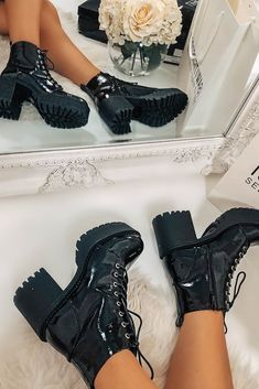 Black faux leather ankle boots in a patent finish with platform cleated sole and lace up front. Platform Ankle Boots, Black Ankle Boots, Leather Ankle Boots, Long Sleeve Bodysuit, Lace Bodysuit, Festival Shop, Satin Trousers, Cycling Shorts, Tiger Print