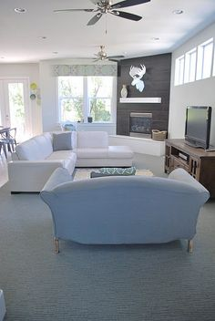 corner fireplace w/ a sectional... good layout.  Something like this (layout wise) could be great.